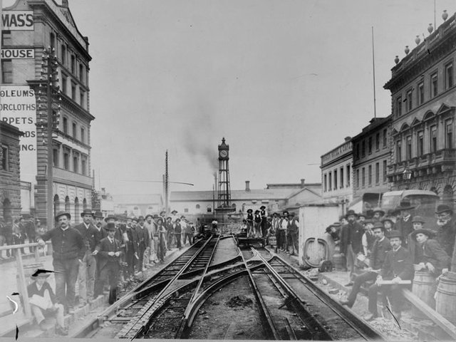 Laying tram tracks on Elizabeth St looking toward Flinders St Station, circa 1910
